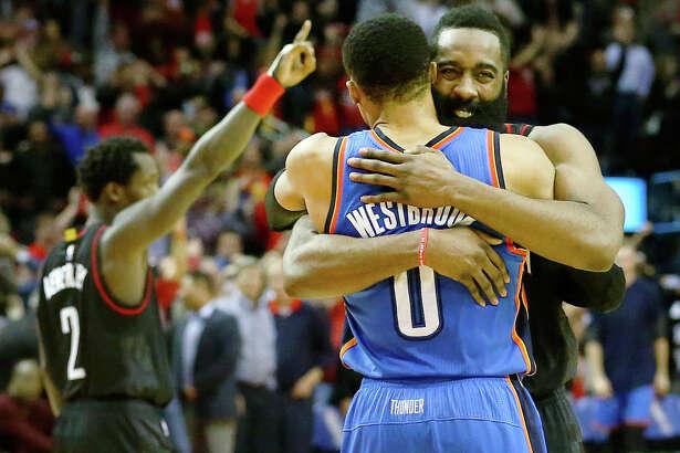 Houston Rockets guard James Harden (13) hugs Oklahoma City Thunder guard Russell Westbrook (0) after the Houston Rockets beat the Oklahoma City Thunder 118-116 during an NBA game at the Toyota Center, Thursday, Jan. 5, 2017, in Houston. ( Jon Shapley / Houston Chronicle )