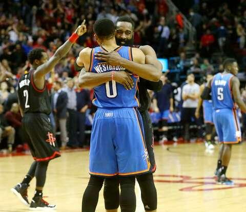 e321b2c6672  p Houston Rockets guard James Harden (13) hugs Oklahoma City Thunder guard