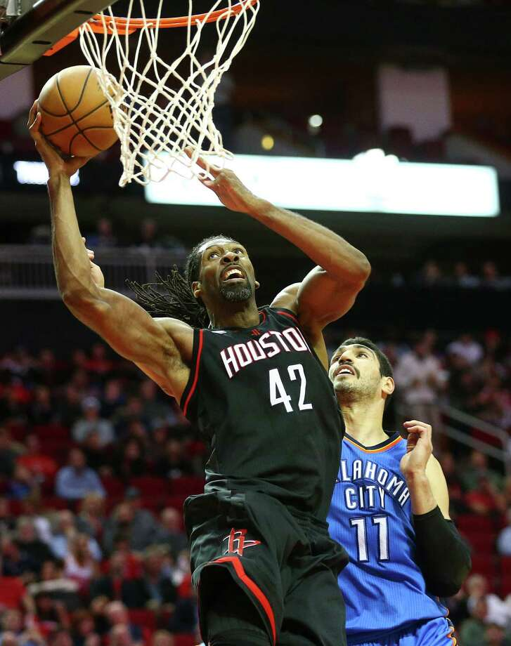 Nene attacks the basket for the Rockets during Thursday night's 118-116 win over the Thunder at Toyota Center. Nene hit all six of his shots en route to 18 points.
