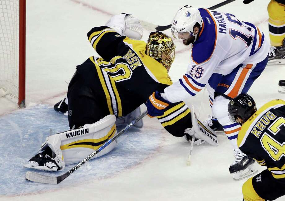 Edmonton Oilers left wing Patrick Maroon (19) scores past Boston Bruins goalie Tuukka Rask (40) in the third period of an NHL hockey game, Thursday, Jan. 5, 2017, in Boston. It was Maroon's third goal of the game. (AP Photo/Elise Amendola) ORG XMIT: MAEA110 Photo: Elise Amendola / Copyright 2017 The Associated Press. All rights reserved.