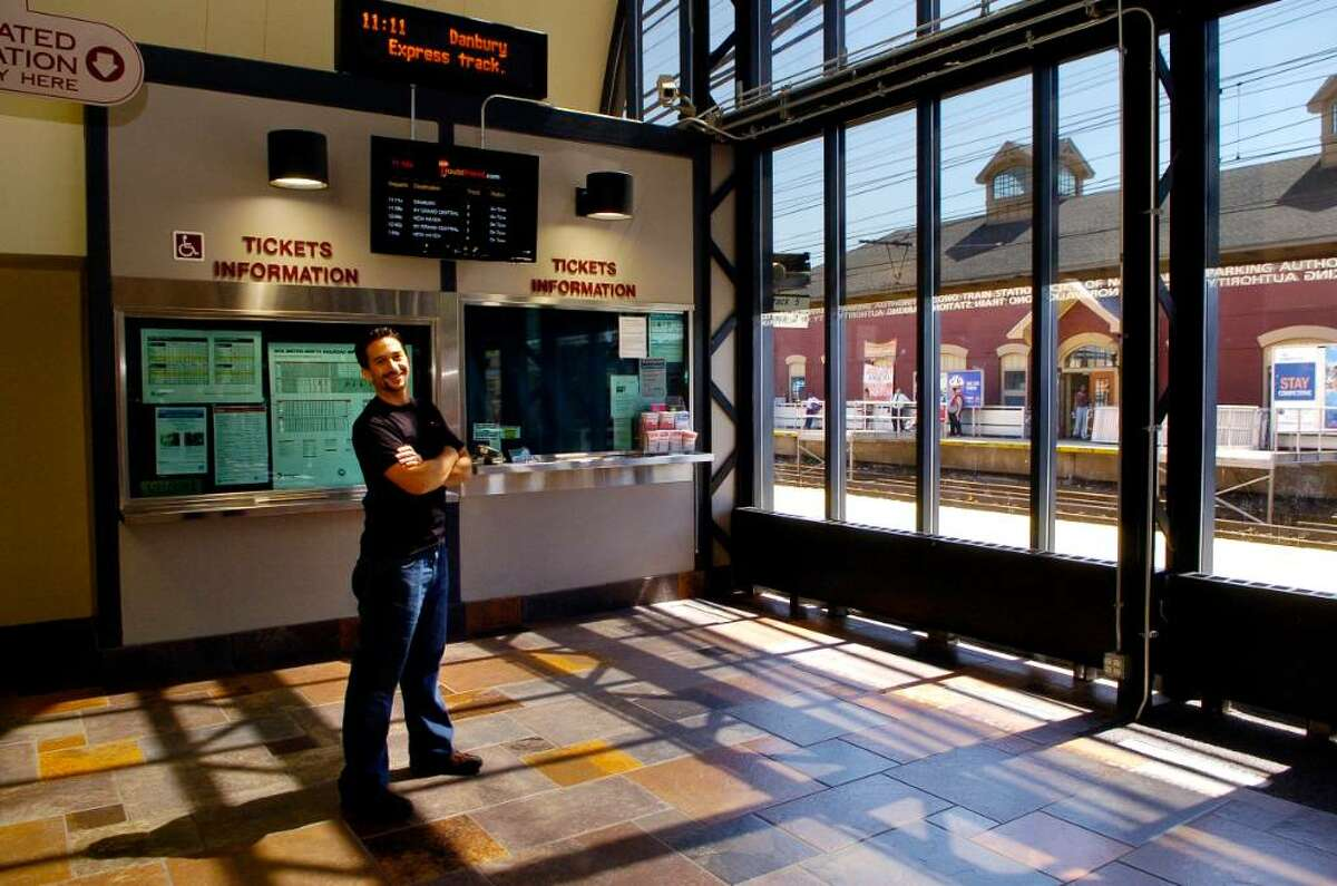 David Marcus, founder of Routefriend, stands in front of one of the departure screens at the South Norwalk train station in Norwalk, Conn. on Tuesday may 25, 2010.