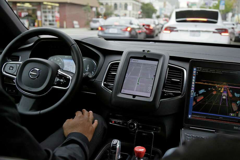 In this photo taken Tuesday, Dec. 13, 2016, an Uber driverless car waits in traffic during a test drive in San Francisco.  The ride-hailing company is refusing to obey demands by the state's Department of Motor Vehicles that it stop picking up San Francisco passengers in specially equipped Volvo SUVs. Hours after Uber launched the self-driving service Wednesday, Dec. 14,  the DMV warned it was illegal because the cars did not have a special permit.  (AP Photo/Eric Risberg) Photo: Eric Risberg / Copyright 2016 The Associated Press. All rights reserved.