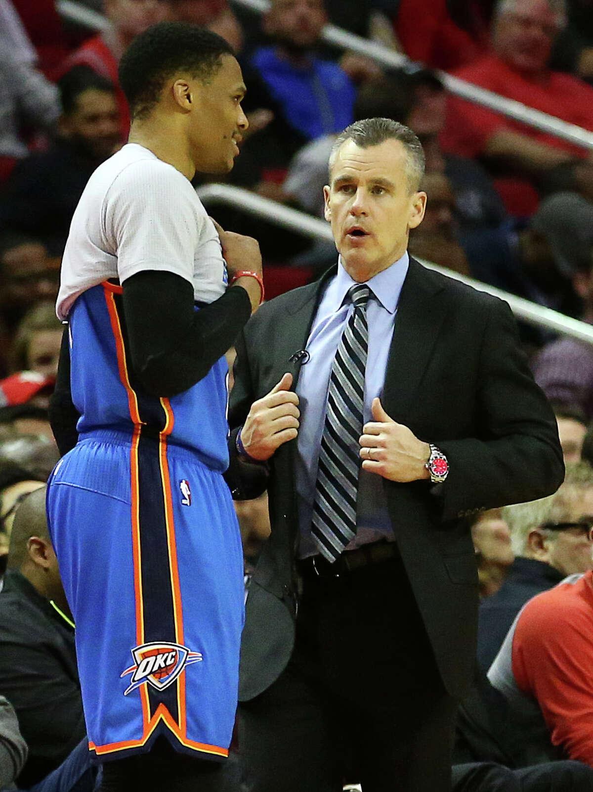 Oklahoma City Thunder head coach Billy Donovan talks with Oklahoma City Thunder guard Russell Westbrook (0) during the fourth quarter of an NBA game at the Toyota Center, Thursday, Jan. 5, 2017, in Houston. ( Jon Shapley / Houston Chronicle )