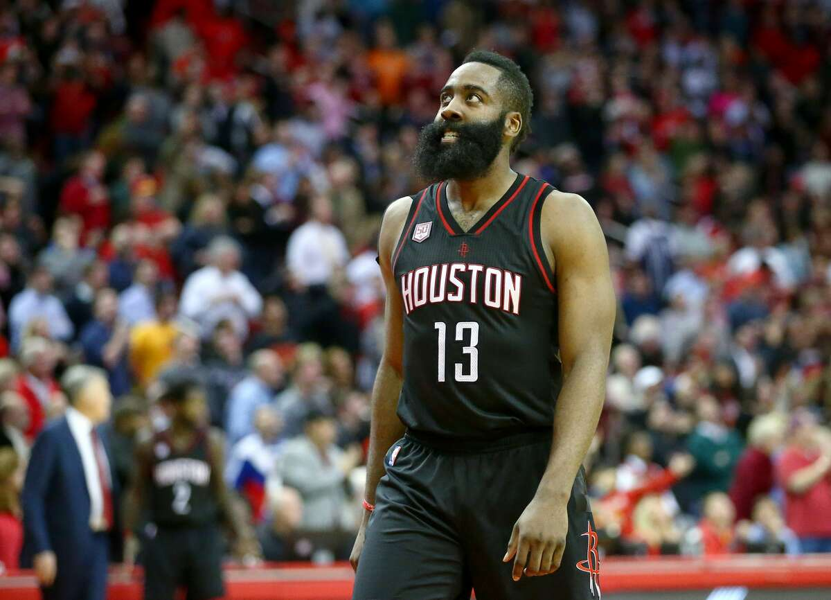 Houston Rockets guard James Harden (13) looks up at the board as center Nene Hilario (42) sets up to take his freethrow shots with less 0.7 seconds left in the fourth quarter of an NBA game at the Toyota Center, Thursday, Jan. 5, 2017, in Houston. ( Jon Shapley / Houston Chronicle )