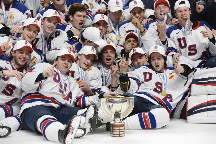 United States players pose with the trophy after defeating Canada in the final of the world junior championship in Montreal on Thursday, Jan. 5, 2017. (Paul Chiasson/The Canadian Press via AP) Photo: Paul Chiasson/Associated Press