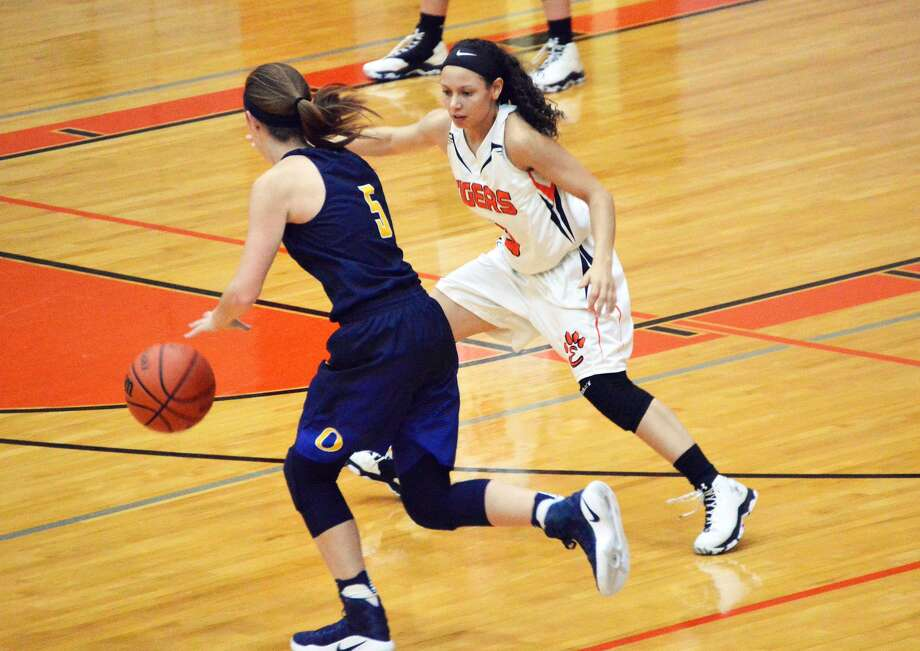 Edwardsville senior Jasmine Bishop, right, guards the O'Fallon ball handler early in the third quarter at Lucco-Jackson Gymnasium.