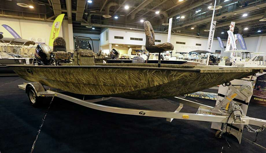 A G3 camouflaged boat during setup for The Houston International Boat, Sport & Travel Show
