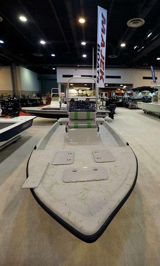 A Majek center console boat during setup for The Houston International Boat, Sport & Travel Show Jan. 5, 2017, in Houston. ( James Nielsen / Houston Chronicle ) Photo: James Nielsen, Staff / © 2017  Houston Chronicle