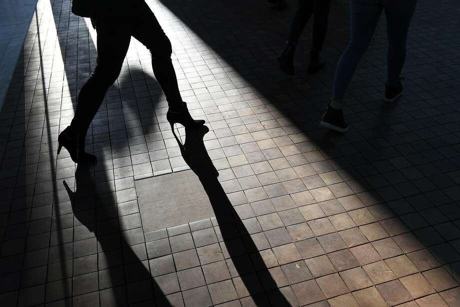 A woman walks across wood tiled flooring on the ground floor of the new Salesforce building at 350 Mission Street in San Francisco, CA, on Thursday, January 5, 2017. Photo: Michael Short, Special To The Chronicle