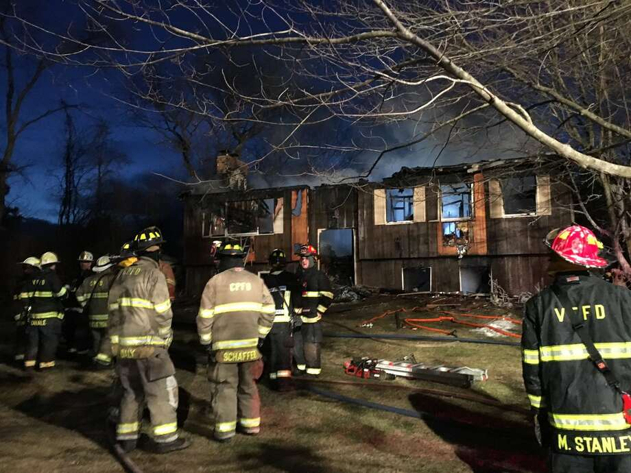 Fire destroyed this home at 58 Ray Road in Clifton Park on Friday. The family escaped the fire which was reported at about 3 a.m. (Emily Masters / Times Union)