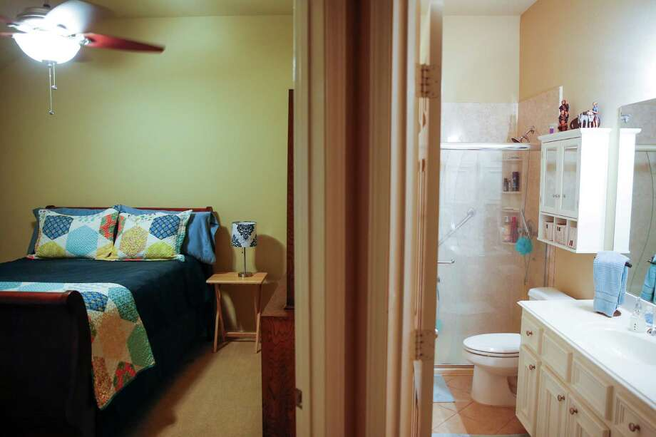A room and bathroom in Emily Ammons and Esteban Estrada's home Thursday, Dec. 22, 2016 in Fresno. The couple has listed their home for the week of the Super Bowl for $1,100/night for two bedrooms, access to the common areas and a ride to and from the big game. ( Michael Ciaglo / Houston Chronicle ) Photo: Michael Ciaglo, Staff / © 2016  Houston Chronicle