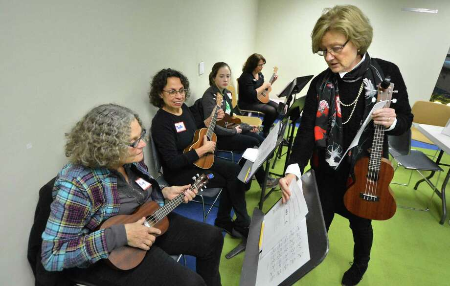 "Children's Librarian and program coordinator Deborah White gets some holiday music to the group during the library's ""Ukelele Meet Up"" Dec. 15. The next monthly meet up will be Jan. 12 and is open to middle school through adult at any level of experience. Photo: Alex Von Kleydorff / Hearst Connecticut Media / Connecticut Post"