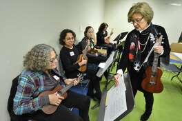 """Children's Librarian and program coordinator Deborah White gets some holiday music to the group during the library's """"Ukelele Meet Up"""" Dec. 15. The next monthly meet up will be Jan. 12 and is open to middle school through adult at any level of experience."""