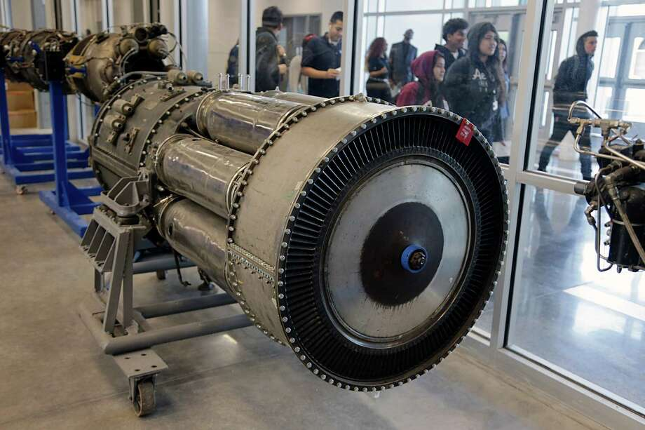 Students walk past an aircraft jet engine in the aviation hanger at HISD's Sterling Aviation High School in the aviation hanger at HISD's Sterling Aviation High School Jan. 4, 2017, in Houston. Photo: James Nielsen, Houston Chronicle / © 2017  Houston Chronicle