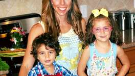 Nutrition's My Life blogger Nicole Eichinger is shown in her kitchen in 2016 with her children Ethan, 2, and Emma, 4,