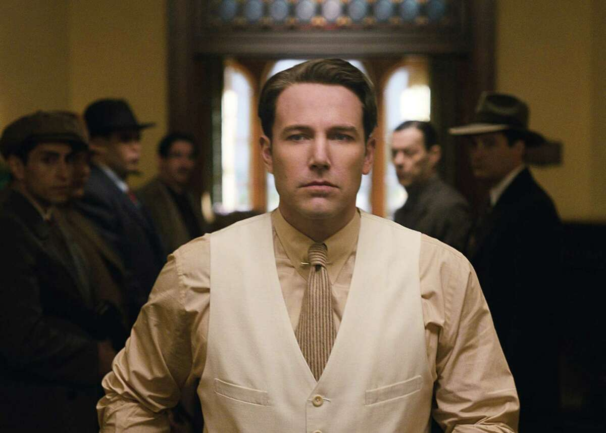 """In this Prohibition-era crime tale adapted from Dennis Lehane's novel, Ben Affleck plays a smarter-than-average Boston mobster who is sent down South to corner the Florida rum business. Affleck also directs, and his only mistake, according to LaSalle, was casting himself as the leading man: """"Affleck seems less like the real thing in 'Live By Night' and more like a wealthy person attending a '30s gangster theme party."""" ** Read full review"""
