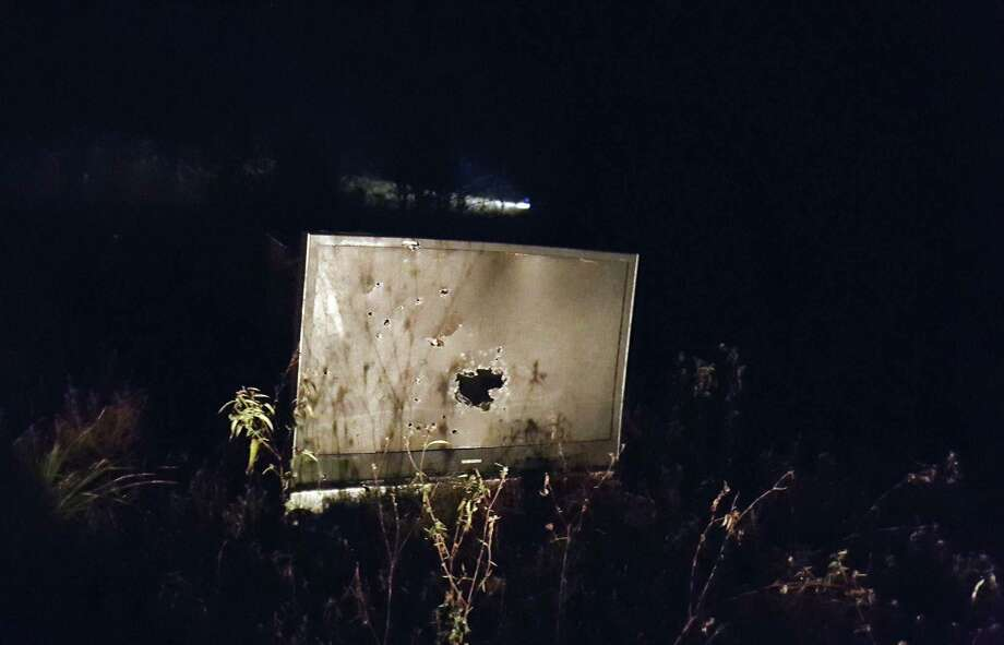An abandoned television that has been used as target practice sits in a field in Kings Colony where Roman Forest Police officers and Montgomery County Precinct 4 Deputies patrolled and took measures to reduce the illegal use of firearms during New Year's Eve Dec. 31, 2016 and New Year's Day morning Jan .1. Photo: Melanie Feuk