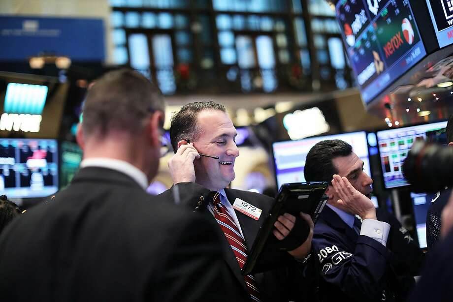 Dow Jones hits 20K for first time