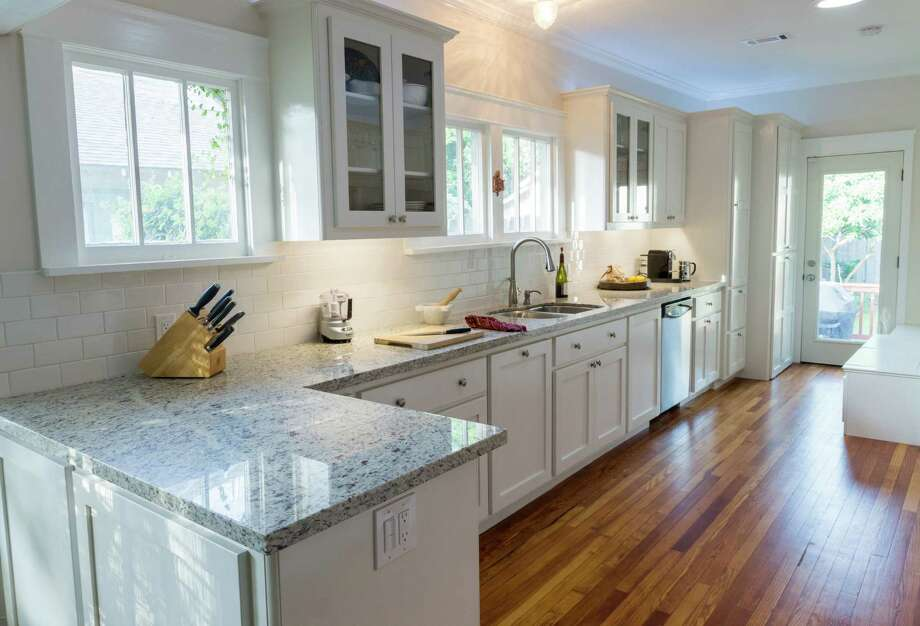 White paint provides an instant face-lift for kitchen cabinets.