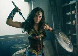 """Gal Gadot made a strong impression as Wonder Woman in the otherwise moribund """"Batman v Superman: Dawn of Justice"""" last year (well, Batman beating up those dudes in the warehouse was fun too). This year, her solo outing, """"Wonder Woman,"""" has a shot at proving not all DC Extended Universe movies have to be a massive drag. Photo credit: Clay Enos and DC Comics; Courtesy Warner Bros Entertainment Inc. and RatPac-Dune Entertainment LLC."""