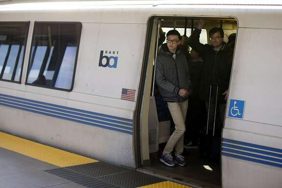 A BART train sits at the West Oakland station, waiting for traffic ahead of it to clear, after a disabled train created 30-minute delays across the system on Friday, Jan. 6, 2017 in Oakland, Calif.