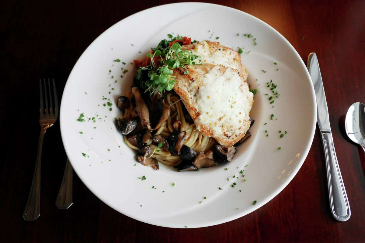 A view chicken madeira served over linguine with a madeira wine and mushroom sauce along with broccoli rabe and sun dried tomatoes at the Westfall Station Cafe, on Wednesday, Jan. 4, 2017, in Averill Park, N.Y. (Paul Buckowski / Times Union)