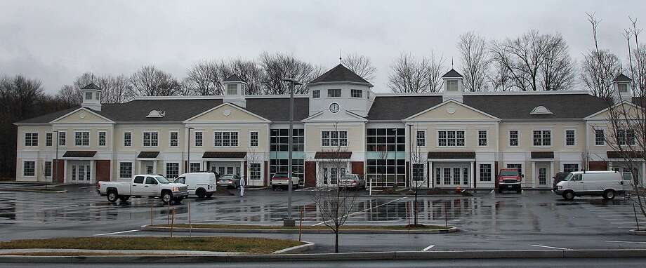 Work continues at the Village at Lexington Gardens on Church Hill Road in Newtown, Conn., on Wednesday, Jan. 4, 2017. The shopping plaza will include a Market Place Kitchen and Bar restaurant. Photo: Chris Bosak / Hearst Connecticut Media / The News-Times