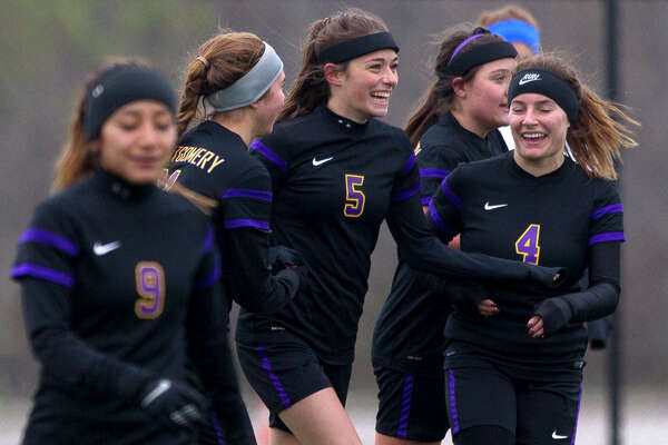 Montgomery's Zoe Barkley (5) celebrates with teammates after scoring a goal during the first period of a girls high school soccer match at the Lady Highlander Invitational Friday, Jan. 6, 2017, in The Woodlands. Montgomery played New Braunfels to a 1-1 draw.