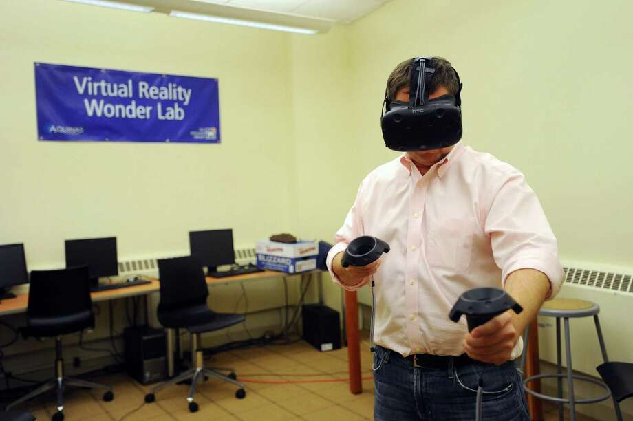 Hugh Seaton, CEO of Aquinas Training, plays on his virtual reality system inside the Ferguson Library in Stamford, Conn. on Monday, Jan. 2, 2017. Seaton offers free demonstrations to the public on Mondays and Saturdays. Photo: Michael Cummo / Hearst Connecticut Media / Stamford Advocate