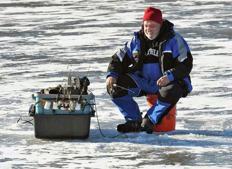 Ice fisherman Dennis Toma of Latham jigs for panfish on a frozen Mohawk River bay Friday Jan. 6, 2017 in Niskayuna, NY.  (John Carl D'Annibale / Times Union) Photo: John Carl D'Annibale / 20039344A