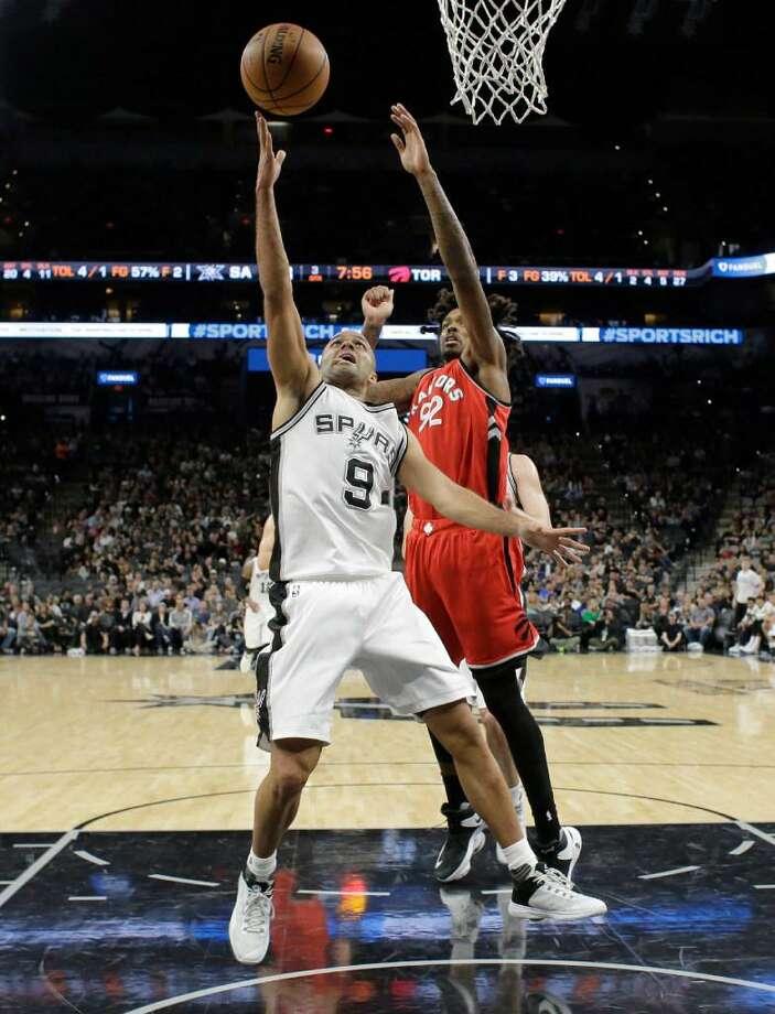 San Antonio Spurs guard Tony Parker (9) shoots past Toronto Raptors center Lucas Nogueira (92) during the second half of an NBA basketball game, Tuesday, Jan. 3, 2017, in San Antonio. San Antonio won 110-82. Photo: Eric Gay /AP Photo