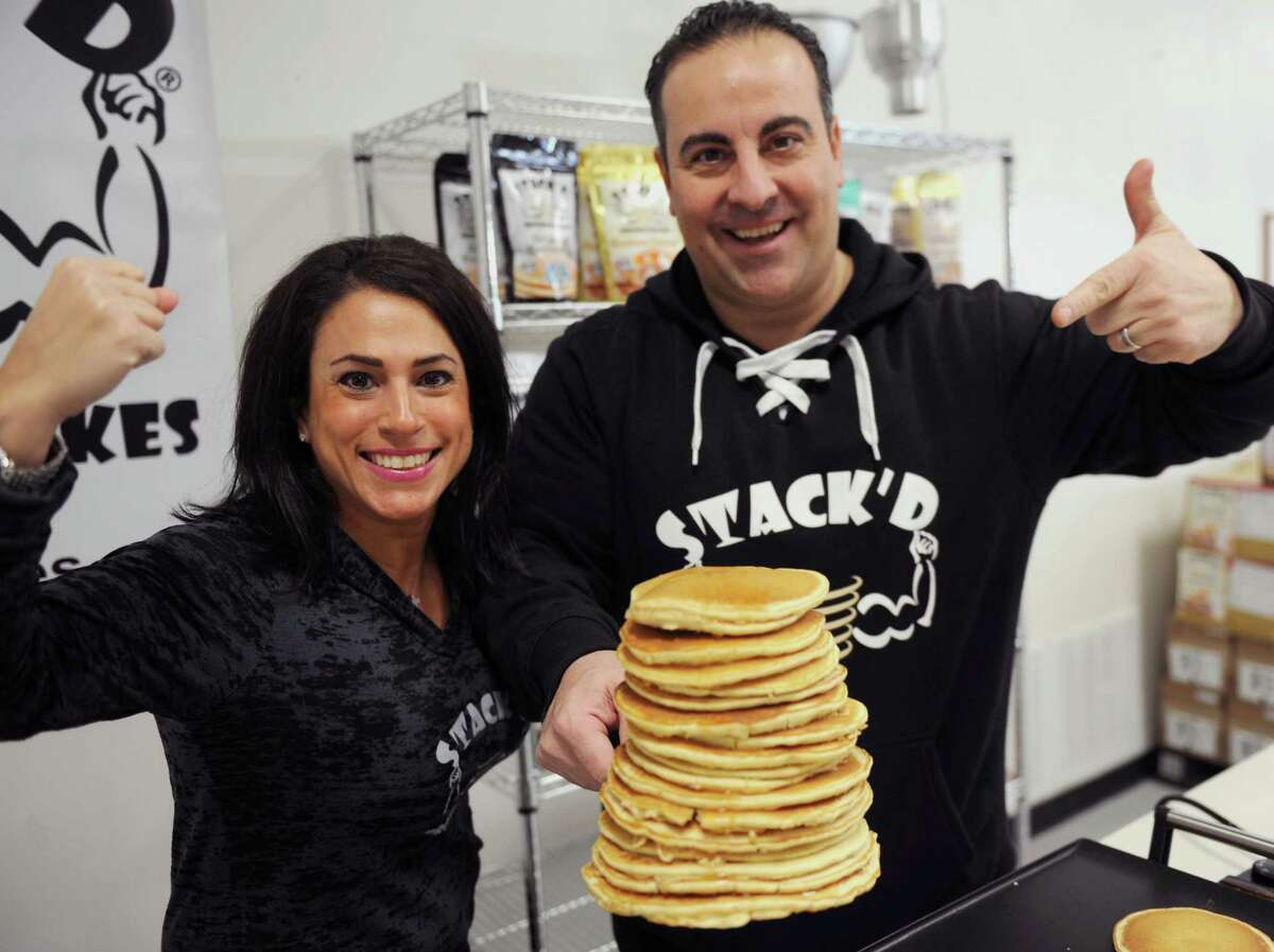 Gary and Lisa Kassabian, owners of STACK'D Nutrition, cook protein pancakes at their company's production facility Friday, Jan. 6, 2017, in Albany, N.Y.