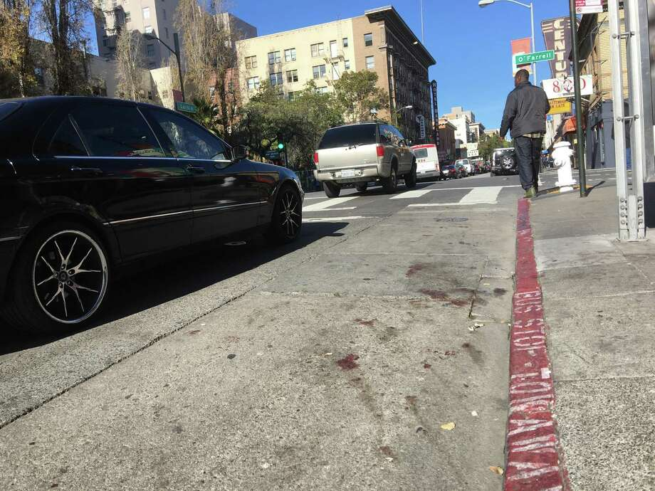 Blood on a sidewalk in San Francisco's Tenderloin marks spot where 61-year-old man was beaten to death by four or five people on Thursday. Photo: Kimberly Veklerov / The Chronicle