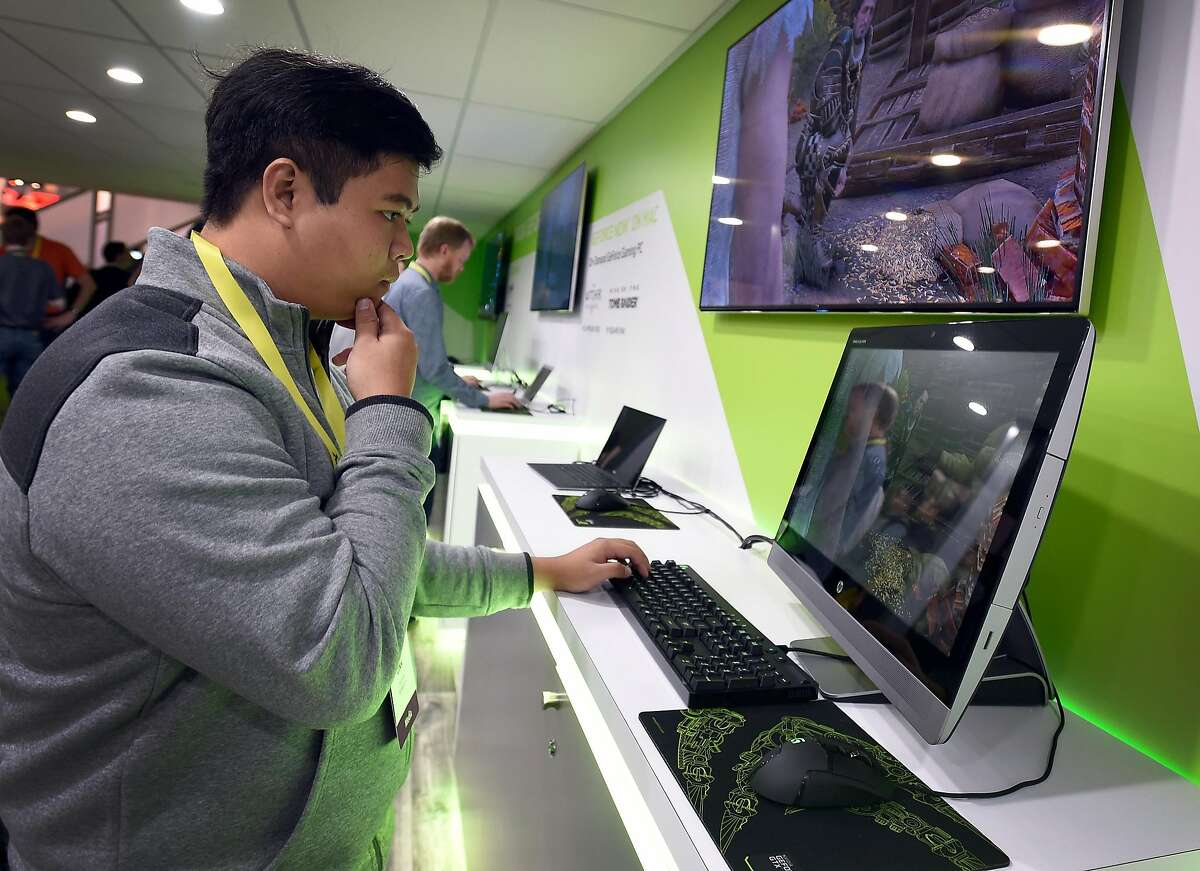 LAS VEGAS, NV - JANUARY 05: An attendee plays a video game at the Nvidia booth at CES 2017 at the Las Vegas Convention Center on January 5, 2017 in Las Vegas, Nevada. CES, the world's largest annual consumer technology trade show, runs through January 8 and features 3,800 exhibitors showing off their latest products and services to more than 165,000 attendees. (Photo by David Becker/Getty Images)