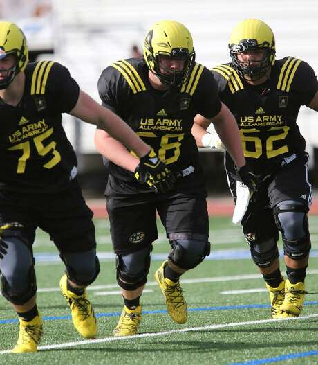 Derek Kerstetter (center) from Reagan High School goes through drills Thursday January 5, 2017 at Comalander Stadium in San Antonio, Texas during practice for the West team for the upcoming U.S. Army All-American Bowl. The game will be played Saturday January 7, 2017 at noon at the Alamodome. Photo: John Davenport /San Antonio Express-News