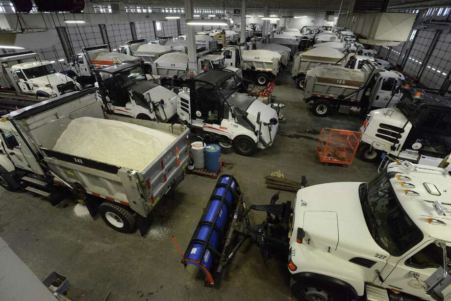 Snow plows stand ready to move out from the City of Stamford Highway and Maintenance facility on Magee Avenue. Crews spent the morning on Jan. 5, 2016 loading salters, preparing for a winter storm that was expected to hit the region overnight. The City Highways Division maintains over 315 miles of roadway, which is the largest municipal road system in the state. Photo: Matthew Brown / Hearst Connecticut Media / Stamford Advocate