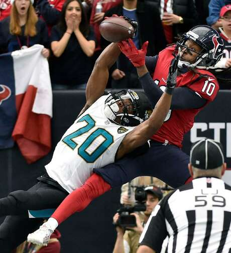 Jacksonville Jaguars cornerback Jalen Ramsey (20) breaks up a pass in the end zone intended for Houston Texans' DeAndre Hopkins during the first half of a Dec. 18 game in Houston. Photo: Eric Christian Smith /AP Photo