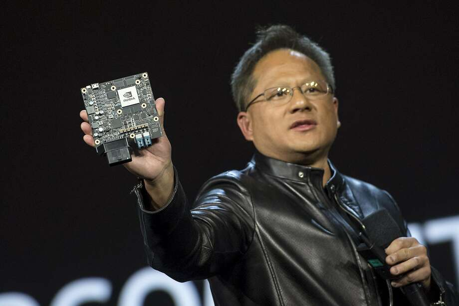 Nvidia CEO Jen-Hsun Huang shows off the new Xavier high-end processor during a keynote presentation at CES in Las Vegas last week. The Santa Clara company was among the best performers on the stock market last year. Photo: David Paul Morris, Bloomberg