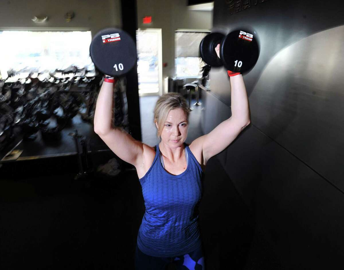 Greenwich resident Amy Dixon, a triathlete who is blind, works out at Combine Training in Greenwich, Conn., Wednesday, Jan. 4, 2017. Dixon will soon be running a camp for blind triathletes later this month in California.