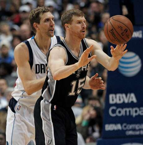 The Dallas Mavericks' Dirk Nowitzki, left, guards the San Antonio Spurs' Matt Bonner (15) in the third period on April 13, 2016, at the American Airlines Center in Dallas. The Spurs won, 96-91. Photo: Paul Moseley /Fort Worth Star-Telegram