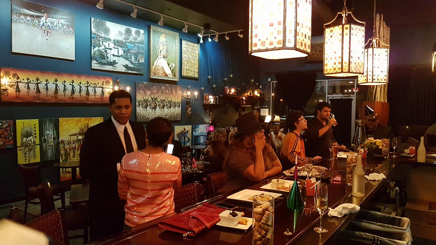 Ogun art wine replaced absolve wine lounge at studemont for Wine painting san antonio