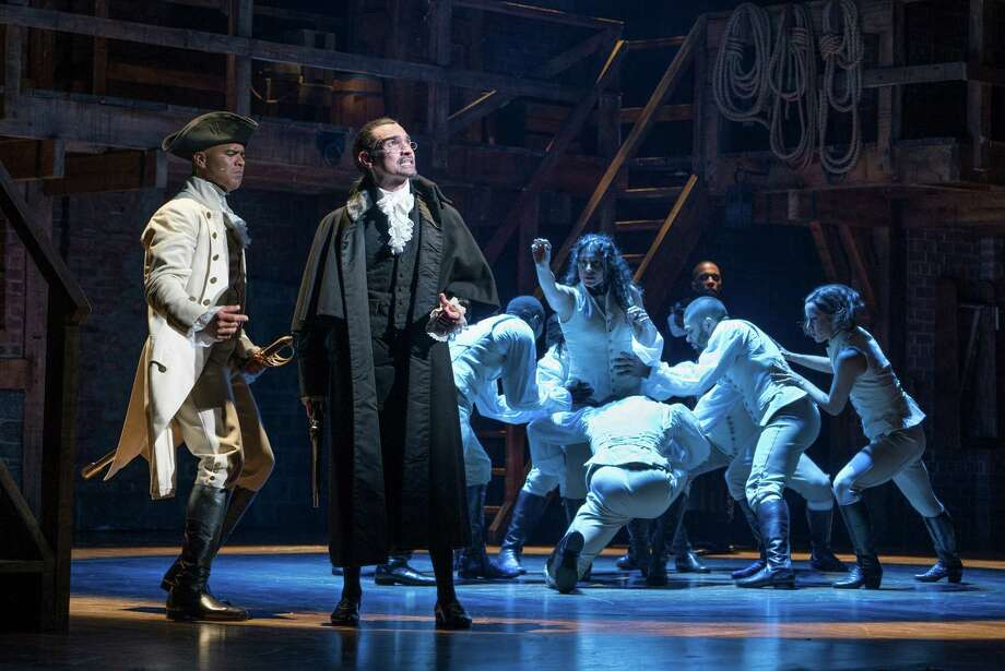 """Christopher Jackson, left, as George Washington and Javier Munoz in the title role of the Broadway musical """"Hamilton"""" at the Richard Rodgers Theater in New York,. Even among historians who love the musical and its multiethnic cast, a question has also quietly simmered: does é'Hamiltoné"""" really get Hamilton right? (Sara Krulwich/The New York Times) Photo: SARA KRULWICH, STF / NYTNS"""