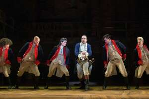"Lin-Manuel Miranda, center, performs with other cast members in ""Hamilton"" at the Richard Rodgers Theater in New York, July 11, 2015. In its move to Broadway, the  show about America's founding fathers is proof that the musical is not only surviving but evolving in ways that should allow it to thrive."