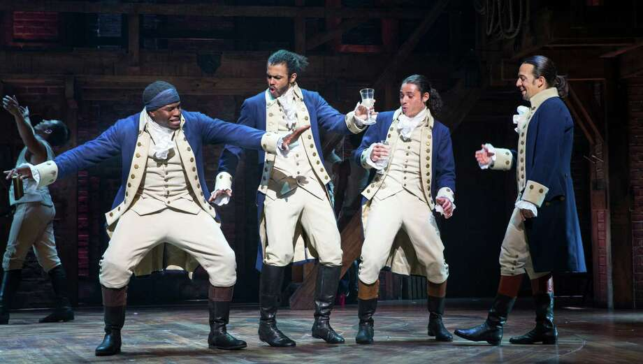 "Okieriete Onaodowan, Daveed Diggs, Anthony Ramos and Lin-Manuel Miranda in ""Hamilton"" at the Richard Rodgers Theater in New York, July 11, 2015. In its move to Broadway, the  show about America's founding fathers is proof that the musical is not only surviving but evolving in ways that should allow it to thrive. (Sara Krulwich/The New York Times) Photo: SARA KRULWICH, STF / NYTNS"