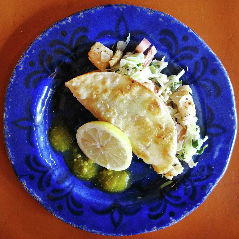 Taco of the Week for Week 2 of 365 Days of Tacos: The Ralphie's Special fish taco with cabbage on a fried tortilla from Taco Haven on South Presa Street. Photo: Mike Sutter /San Antonio Express-News
