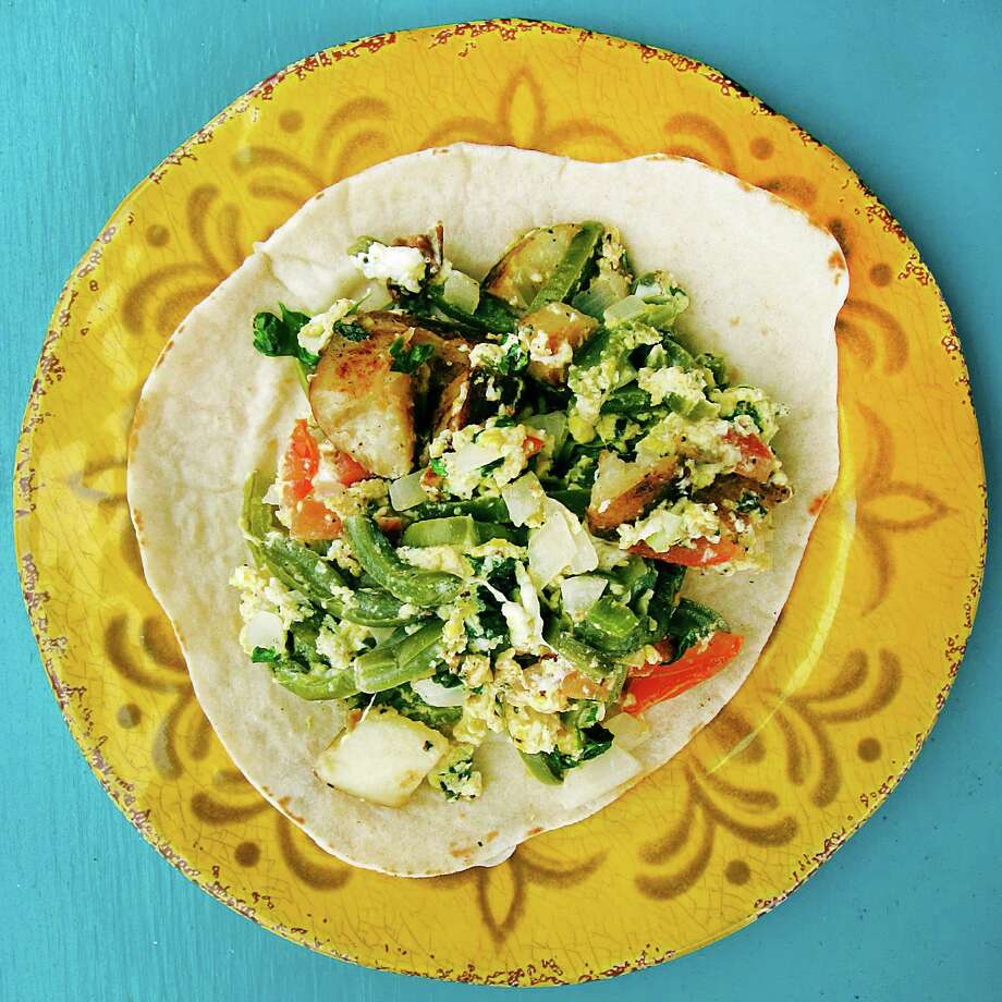 The Hackberry a la Mexicana taco from Amaya's Cocina on East Commerce Street. The Hackberry includes eggs, nopales, potatoes, onions and tomatoes. Photo: Mike Sutter /San Antonio Express-News