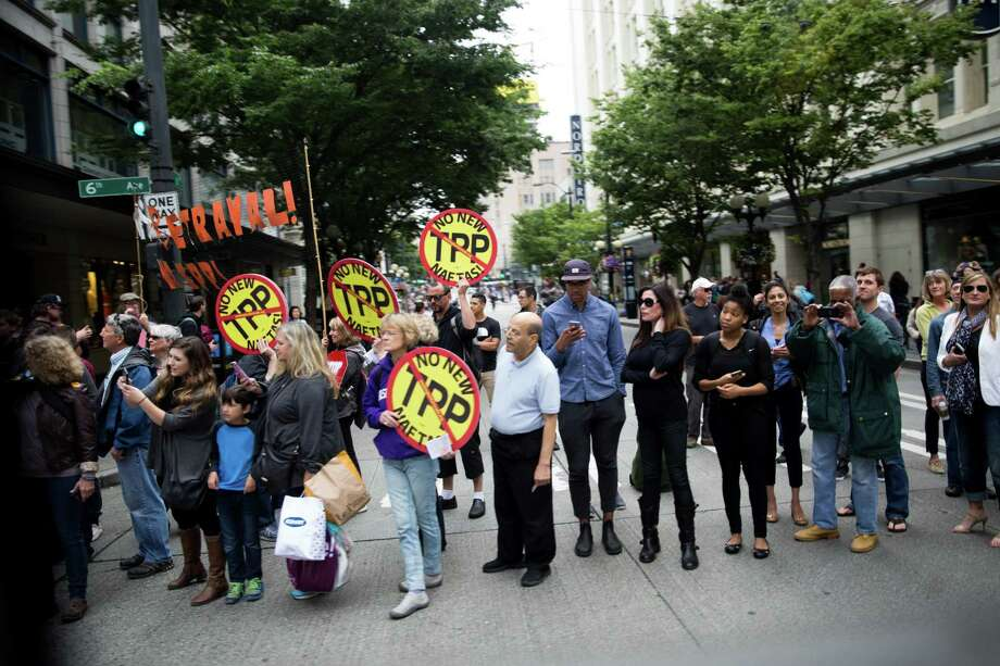 Trans-Pacific Partnership protesters gather in Seattle in June. Under the TPP, regulations on food additives, animal drugs, pesticides or herbicides, and GMOs could be taken as violating partnership rules. Photo: Grant Hindsley /Seattlepi.com / SEATTLEPI.COM