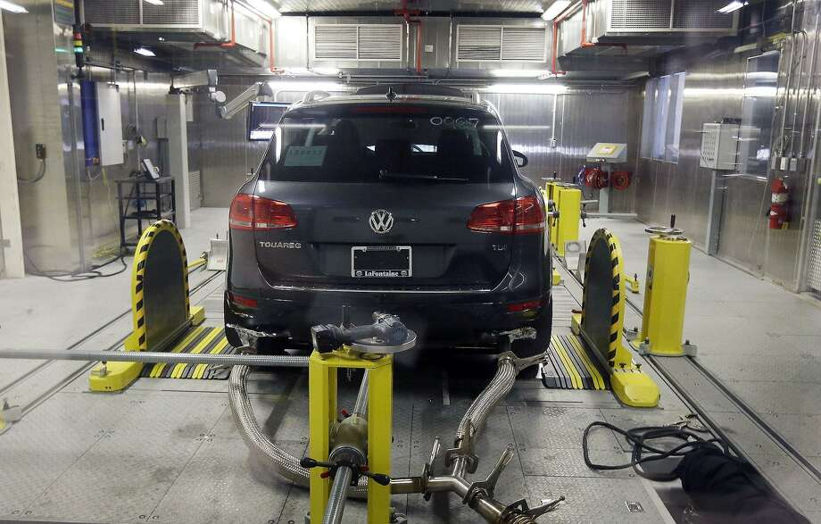 A Volkswagen Touareg diesel is tested in an Environmental Protection Agency's facility in Ann Arbor, Mich. The U.S. Environmental Protection Agency and the California Air Resources Board have approved a fix for around 67,000 of the 475,000 Volkswagens and Audis with 2-liter diesel engines that were programmed to cheat on U.S. emissions tests. Photo: Associated Press /File Photo / Copyright 2016 The Associated Press. All rights reserved.