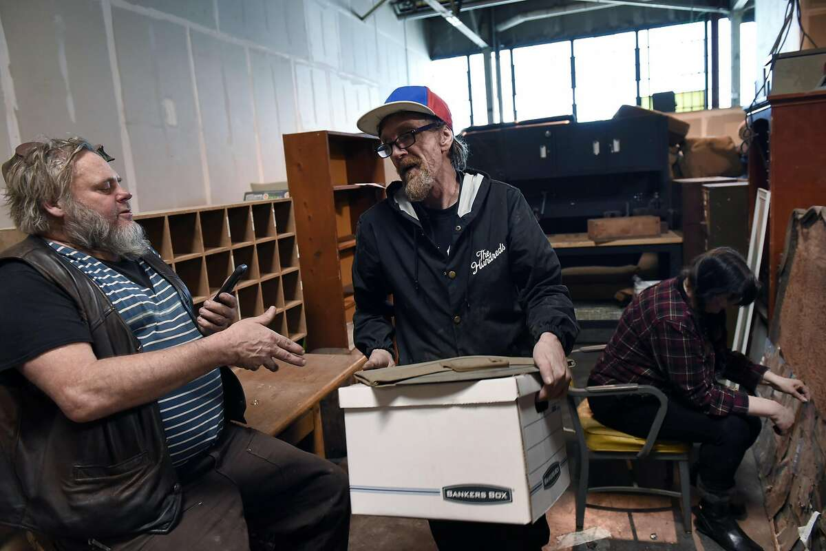 Artist Steve Heck, left, gets help from friends Paul Casteel, and Carrie Pangrace as he moves his studio out of a shared space at The Gate 510, a co-working space in San Leandro, CA, on Thursday, January 5, 2017.