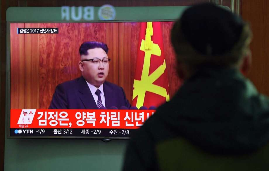 Aa man watching a television news broadcast Dec. 31 at a railway station in Seoul showing North Korean leader Kim Jong-Un's New Year's speech. Pyongyang warned it was close to test launching a ballistic missile. Photo: JUNG YEON-JE /AFP /Getty Images / AFP or licensors